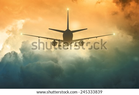 Airplane trying to land in a fog - stock photo