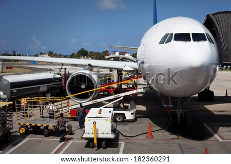 Airplane Unloading the Luggage at San Andres Airport in Colombia - stock photo