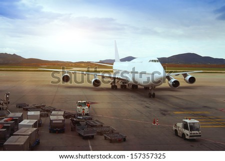 Airplane, view from airport terminal - stock photo