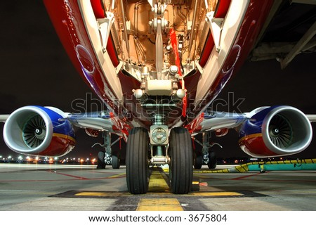 Airplane view from landing gear at night - stock photo