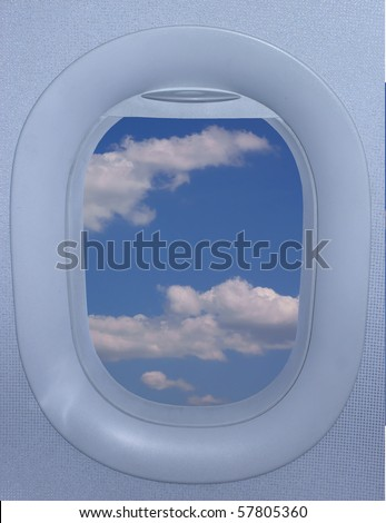 Airplane window of an jet airplane with a beautiful sky - stock photo