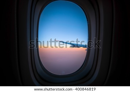 Airplane window sunrise background - stock photo