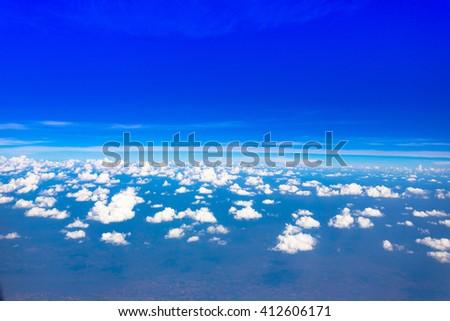 Airplane window view, Blue sky cloudy - stock photo