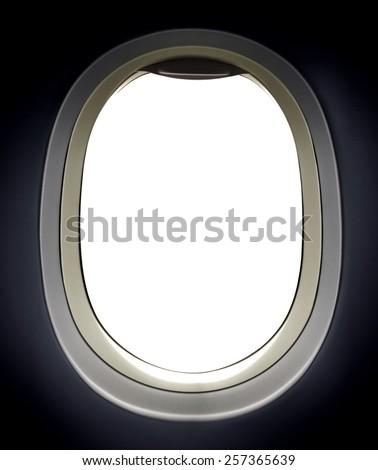 Airplane window view over white - stock photo