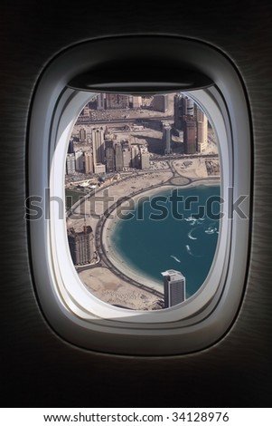 airplane window with dubai marina view - stock photo