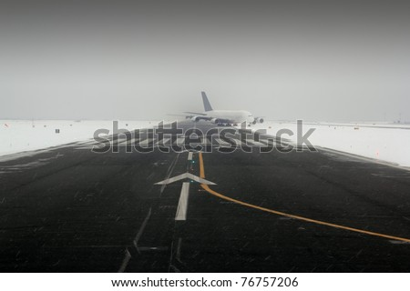 airplane wing aircraft turbine landing in snow winter runway - stock photo