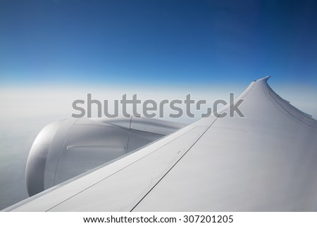 Airplane wing and engine