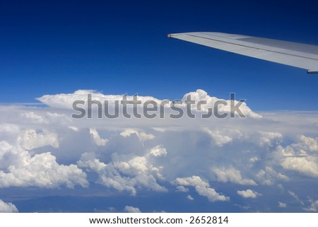 Airplane Wing in Flight - stock photo