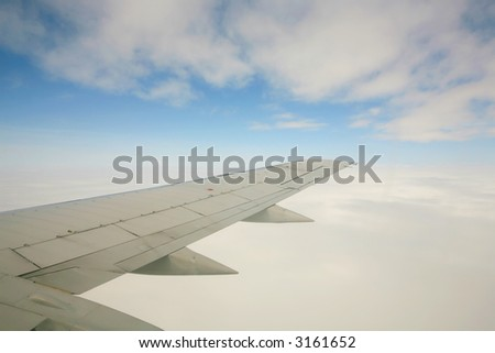 Airplane wing in the clouds