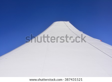 Airplane Wing or Aircraft Wing on clear blue sky background