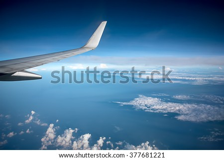 Airplane Wing Through Window - stock photo