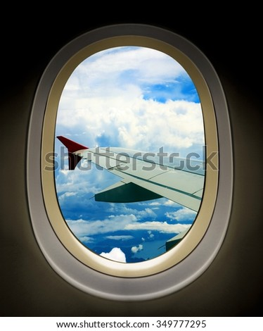 Airplane wing view from window seats - stock photo