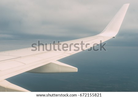 Airplane Wing View Out Of The Window On Cloudy Sky Background Travel Inspiration