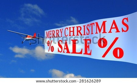 "airplane with banner ""x-mas sale"" - stock photo"