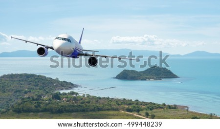 Airplane with beautiful ocean and island in background, explore the world