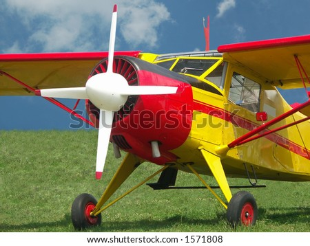 Airplane with four-bladed propeller - stock photo