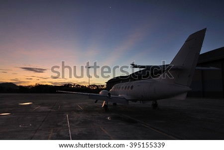 Airplane with moment ray of sunrise