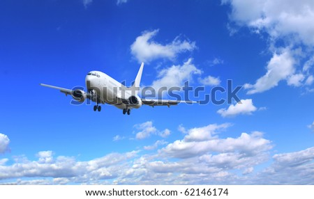 Airplane with perfect sky background - stock photo