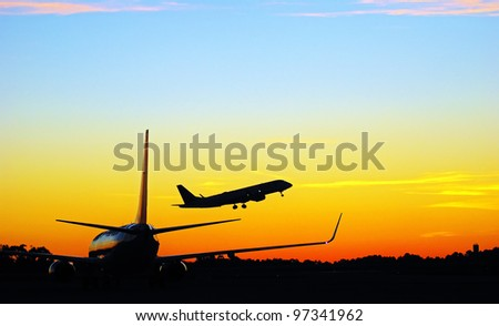 airplanes in sunrise - stock photo