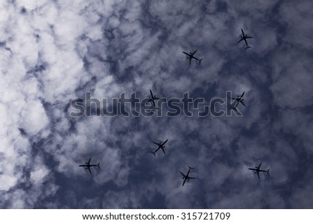 Airplanes in the sky with different directions - stock photo