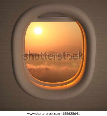 Airplanes window seat view with sunset/sunrise - stock photo