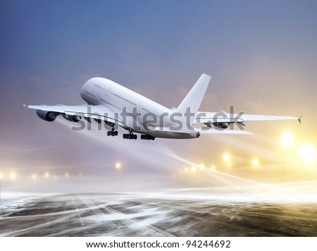 airport and white plane at non-flying weather, blowing snow - stock photo