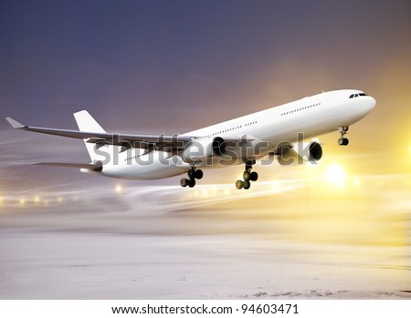 airport and white plane taking off at non-flying weather, snowstorm - stock photo