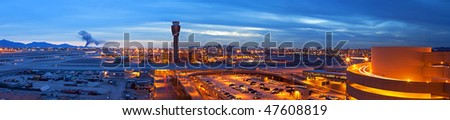 Airport at dusk, with city lights in back. - stock photo