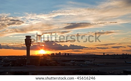 Airport at sunset with city skyline. - stock photo