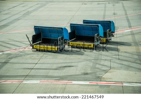 airport baggage truck - stock photo