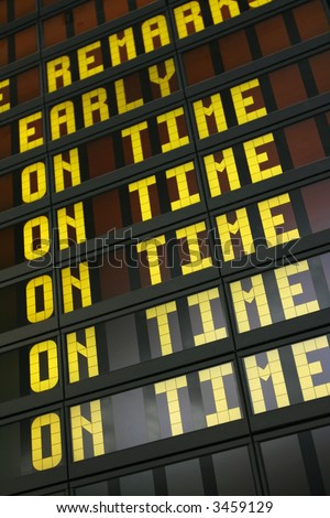 Airport board showing arrivals and departures on time - stock photo