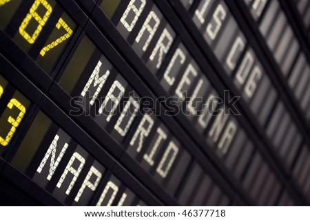 Airport Board With Arrivals Departures Close Up - stock photo