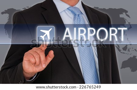 Airport - Businessman with touchscreen - stock photo