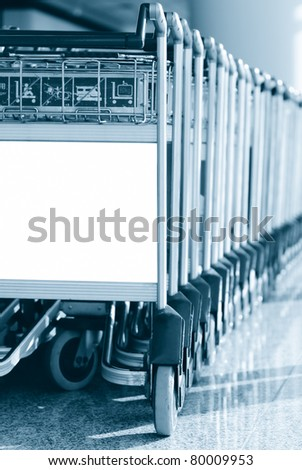 Airport cart with advertisement space in blue tone - stock photo