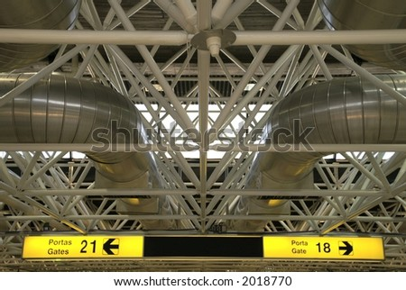 Airport ceiling and departure gates signs - stock photo
