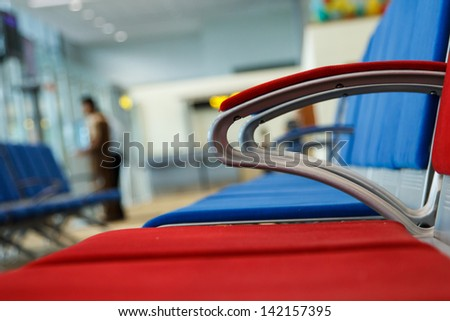 Airport chair waiting for the plane - stock photo