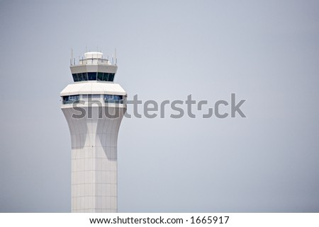 airport control tower, modern design against clear sky with copyspace - stock photo