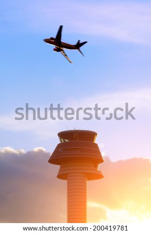 Airport control tower, passenger airplane  - stock photo