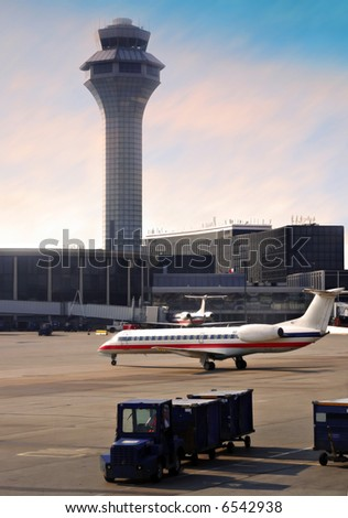 Airport Control Tower under Morning Sunlight - stock photo