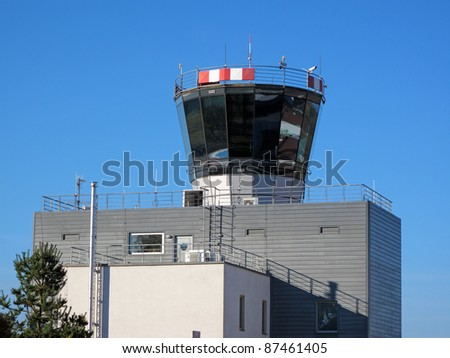 Airport control tower with clear blue sky. - stock photo