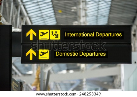 Airport Departure & Arrival information board sign - stock photo