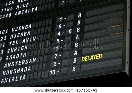 Airport departure board in terminal with flight information - stock photo