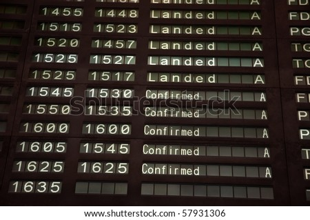 Airport Departure Board, Landed and confirmed - stock photo