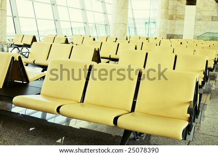 Airport departure lounge with yellow chairs