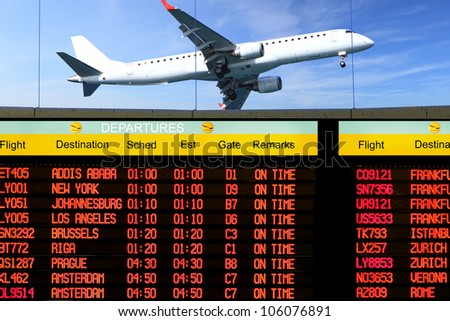 Airport electronic display screen timetable of departures - stock photo