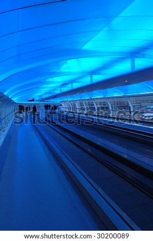 Airport Escalator in blue light at night