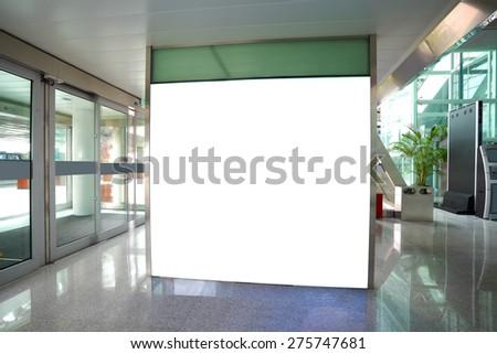 Airport exit door glass wall corridor wall lightboxes - stock photo