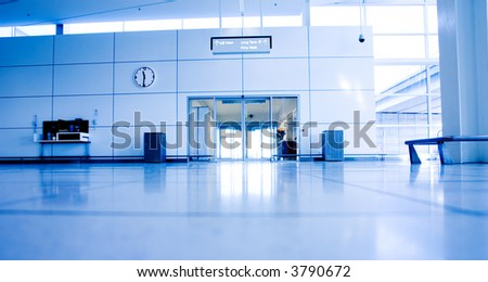 Airport Exit with clock and phones
