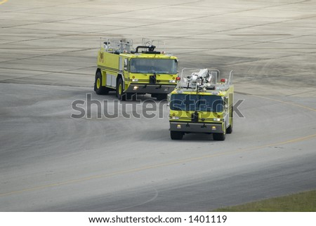 Airport Fire/Rescue trucks heading to an emergency - stock photo