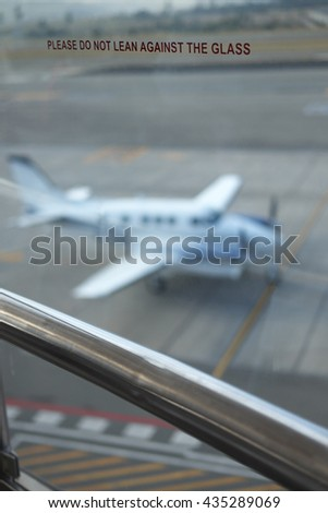 Airport Glass with plane in background - stock photo